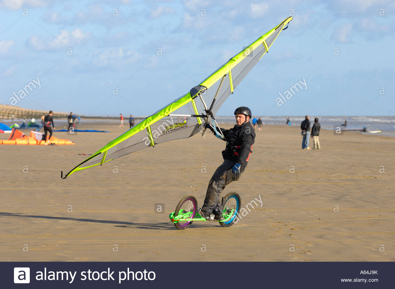 land-board-surfer-on-the-beach-at-camber-sands-rye-east-sussex-england-A64J9K.jpg