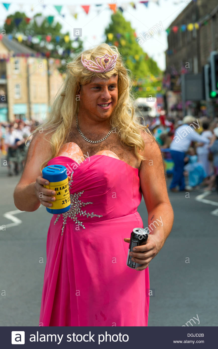 man-wearing-a-wig-and-pink-dress-bakewell-carnival-parade-an-annual-DGJD2B.jpg